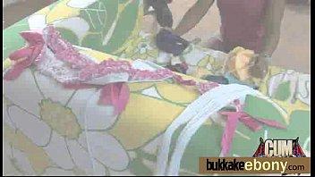 Ebony takes a facial in a club bukkake party 8