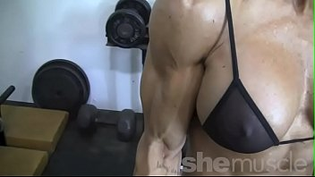 luxurious blond dame bodybuilder in observe thru top.