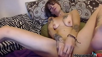 Tattooed housewife with pierced tongue anal masturbating