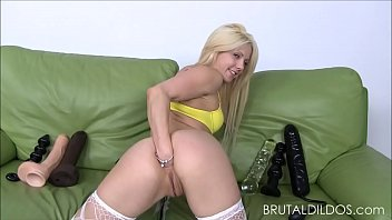 Petite blonde Holly Hanna gapes her ass with big dildos