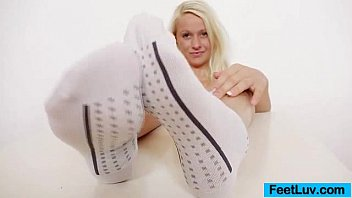 Good-looking blonde Lilith rubs and creams her feet